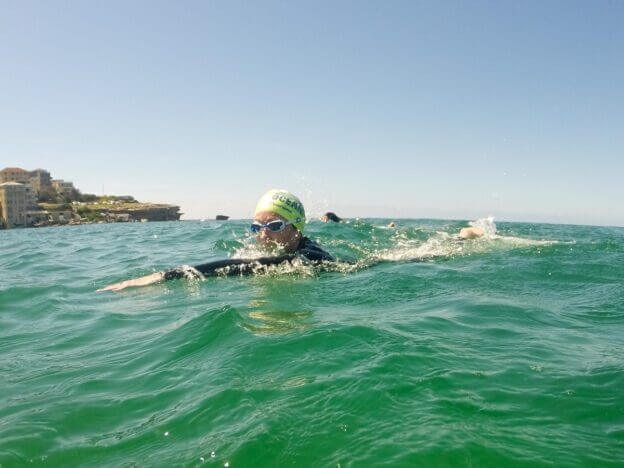 Woman sighting while she swims int he ocean