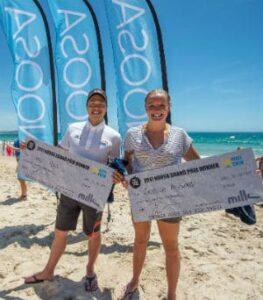 Yasu Hirai & Jessica Ashwood with their winners checks.