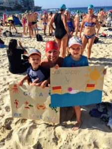 jamie and kids with sign